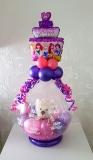 kado in een ballon met beertje en folieballon taart
