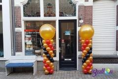 Balloon Styling ballonnendecoratie ballonnenpilaar ballonpilaar goud zwart rood met gouden topballon Tilburg