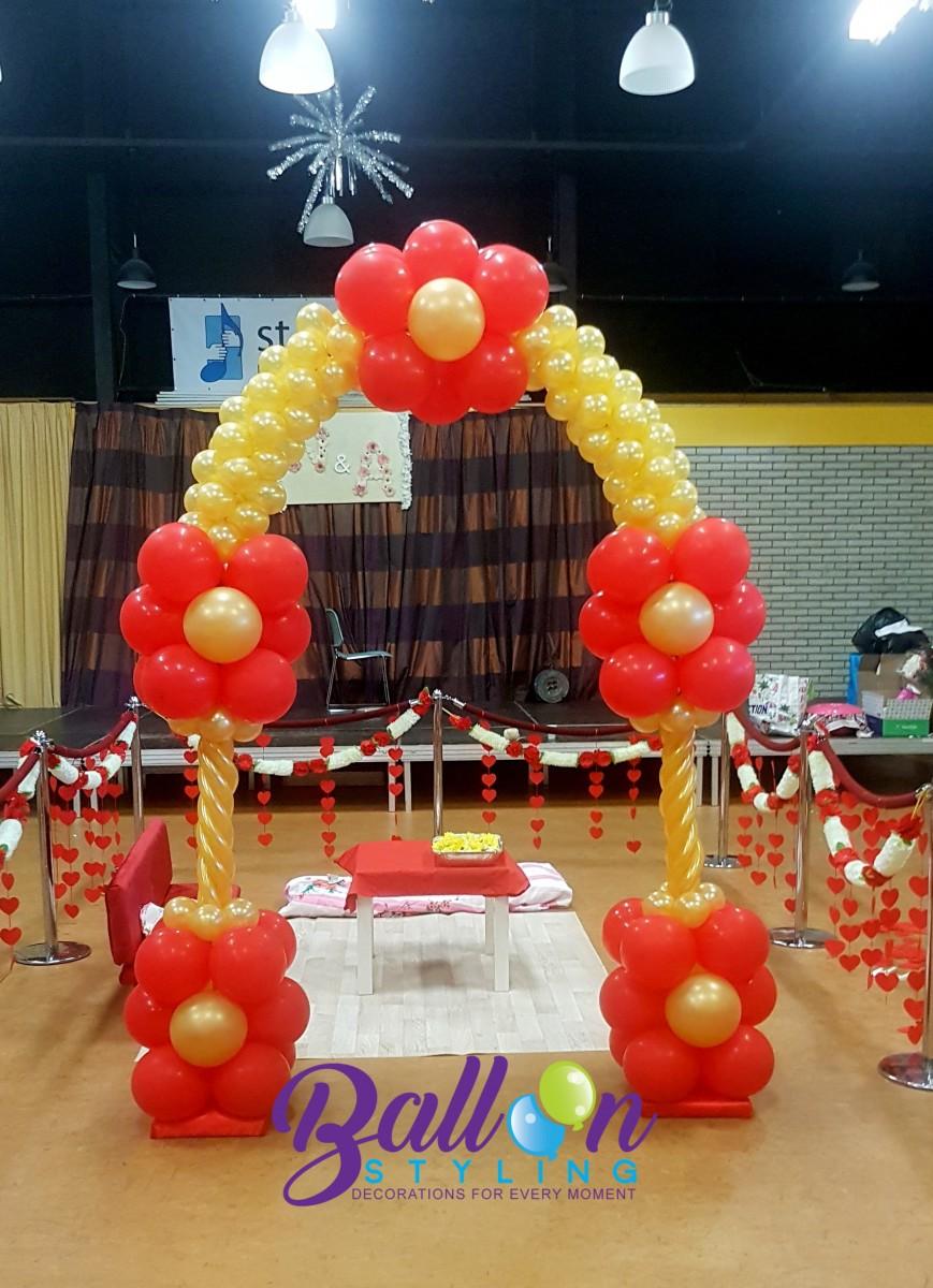 Balloon Styling ballonnenboog ballonboog rood en metallic goud ballonnen Tilburg